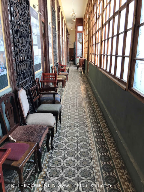 Different chairs and tiled hallway at restaurant La Guarida in Havana in Cuba