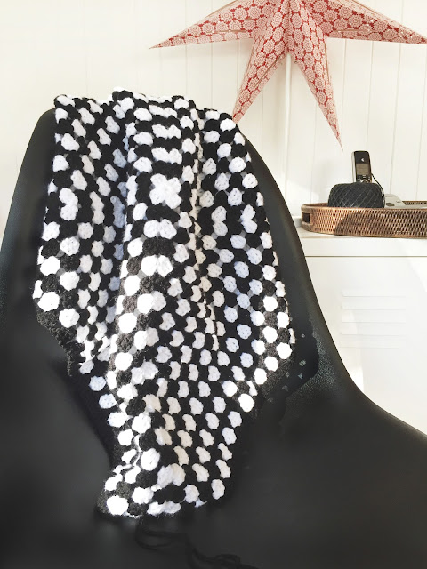 black and white granny square crochet blanket