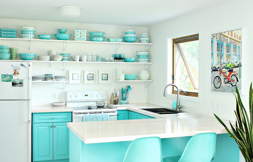 Aqua kitchen with turquoise pyrex and light maple counters
