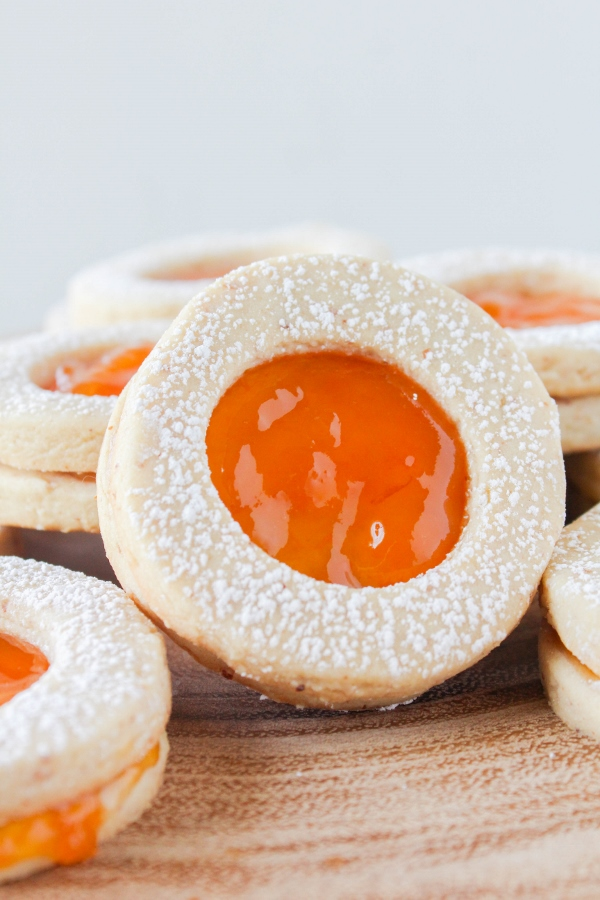 These beautiful, buttery almond shortbread cookies are sandwiched between a light and fresh apricot jam. These classic Linzer cookies are perfect for any of your spring special occasions!