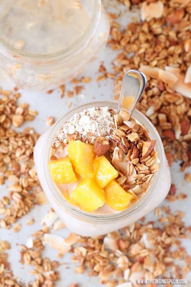An easy & healthy recipe for creamy mango overnight oats made with as little as six ingredients like rolled oats, milk (dairy or non-dairy), real maple syrup, and fresh or frozen mango (which is full of vitamin C + A & fiber). A mere five minutes (or so) of prep the night before gives you healthy grab-and-go breakfasts for days.