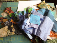 pile of possible fabrics for landscape