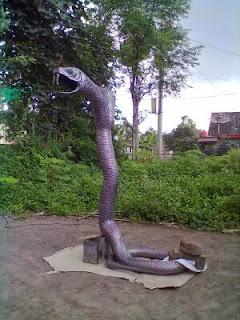 patung ular tembaga.jpg
