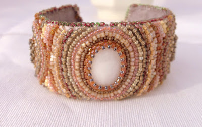 https://www.etsy.com/listing/110045256/hand-woven-pink-gold-and-grey-bead?ref=hp_rv
