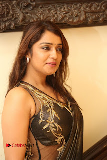 Nikitha looks ravishing in Black Transparent shining saree and glittering Transparent Blouse