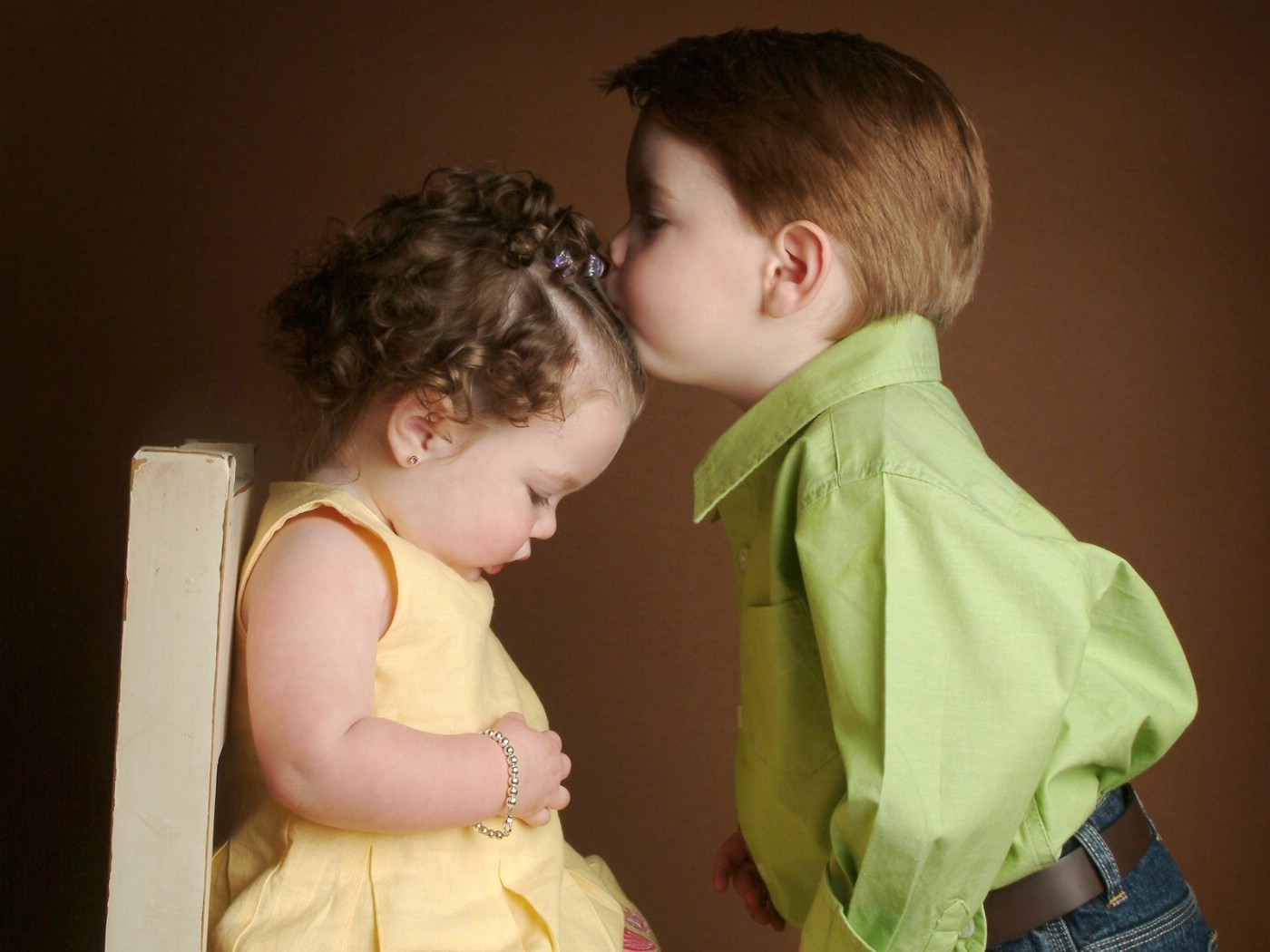 adorable baby couple kissing each other