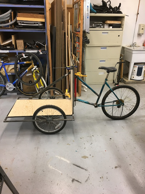 photo of a bike frame with the beginnings of a box in front