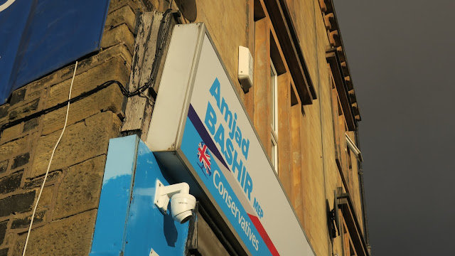 Shop sign for Amjad Bashir, M.E.P. for Yorkshire and the Humber.