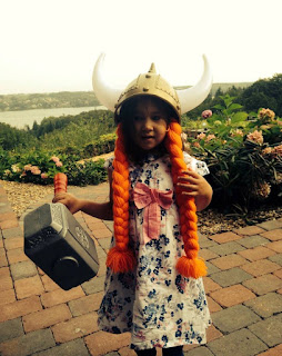 Little girl dessed up as a viking