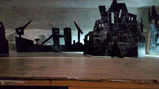 Diorama 3-d stage set combining sculpture and printmaking