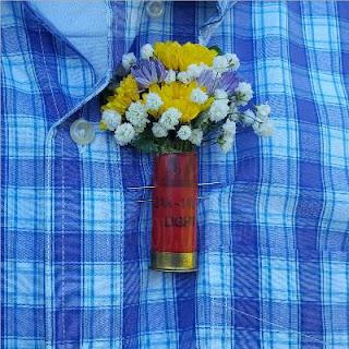 a shotgun shell boutonniere made for Randy and Dawns wedding