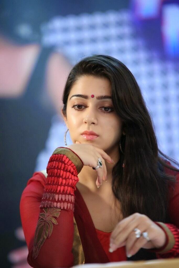 Rosy fair Charmi kaur photos in red salwar kameez at country club asia's biggest new year bash 2014 press meet