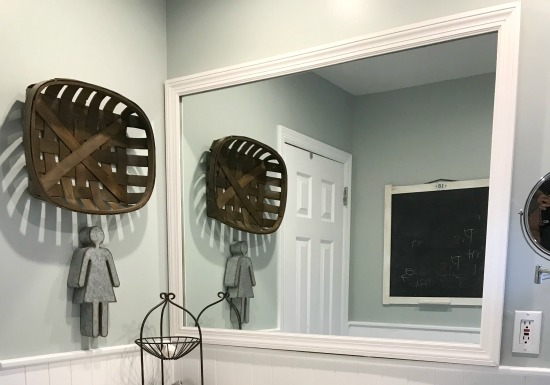 Framing a mirror for A Neutral Farmhouse Bathroom Makeover