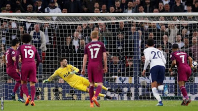 Man City close in on title after win at Spurs