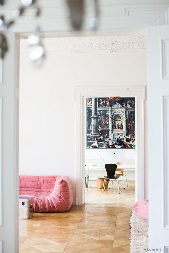 Pink Ligne Roset Togo in modern space