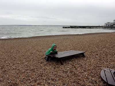 cafe bench buried in shingle after winter storms