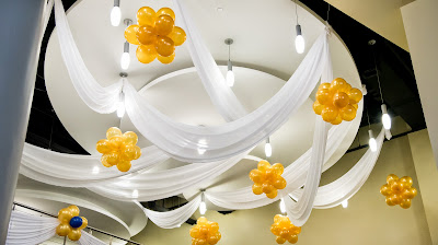 Ceiling drapes with balloon decorations
