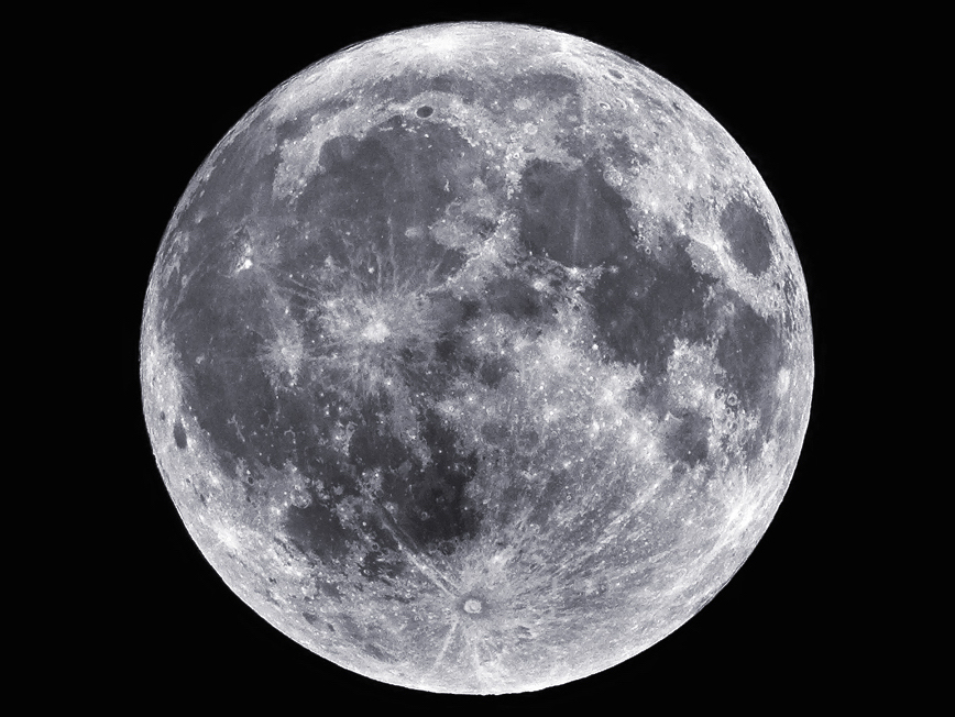 Silver full moon in a cloudless pitch-black sky