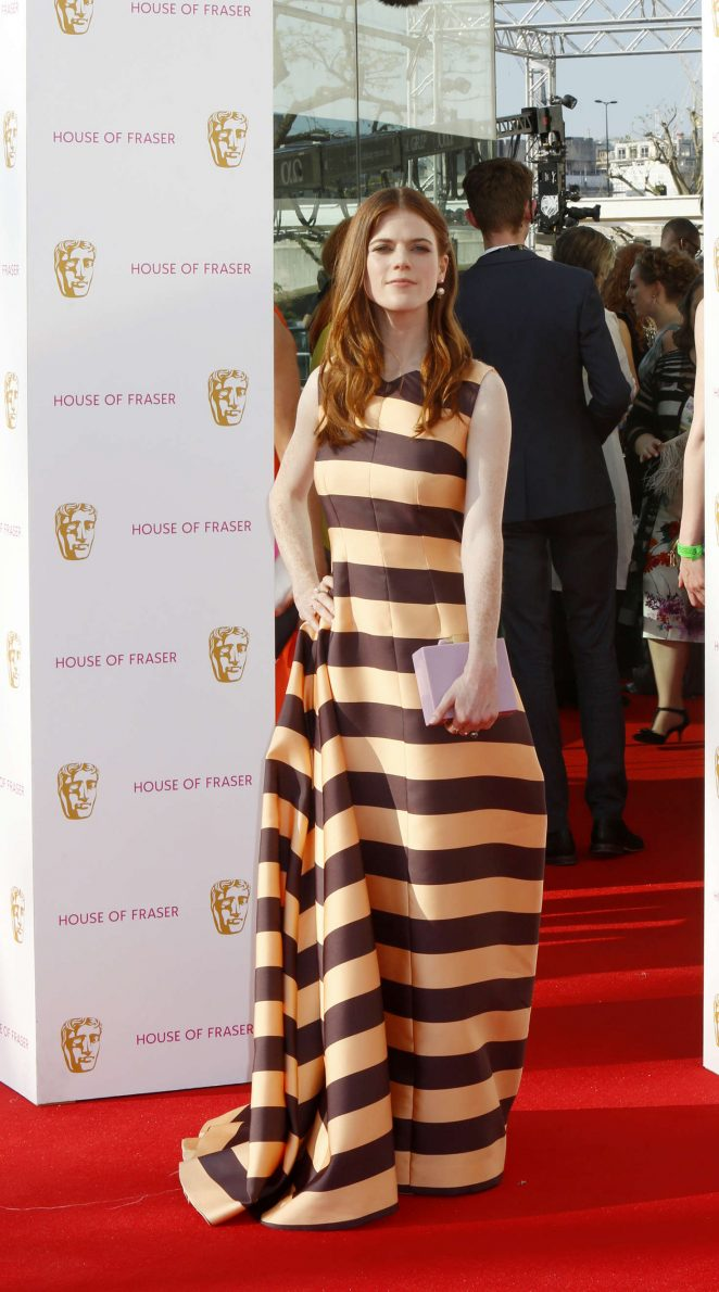 Rose Leslie in a gold and black gown at the BAFTA TV Awards 2016