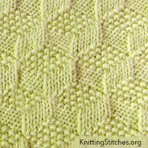 Tumbling Moss Blocks is a simple, reversible with moss and garter stitches.