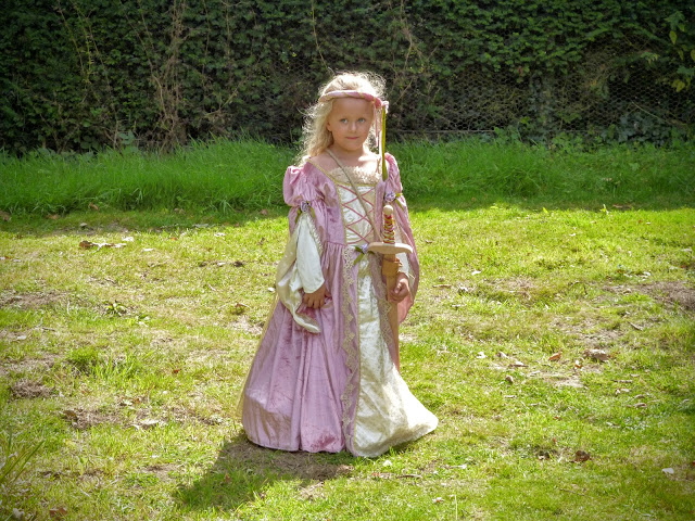 young girl dressed as a princess with sword at a medieval festival