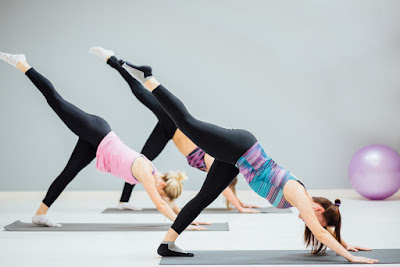 A group of women in yoga poses.