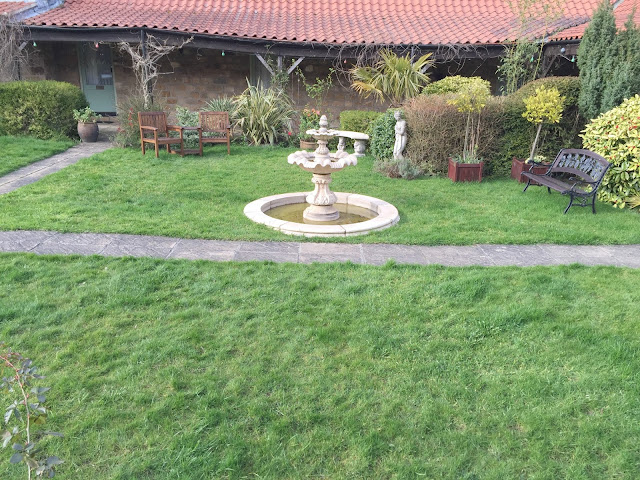garden fountain at ox pasture hall hotel