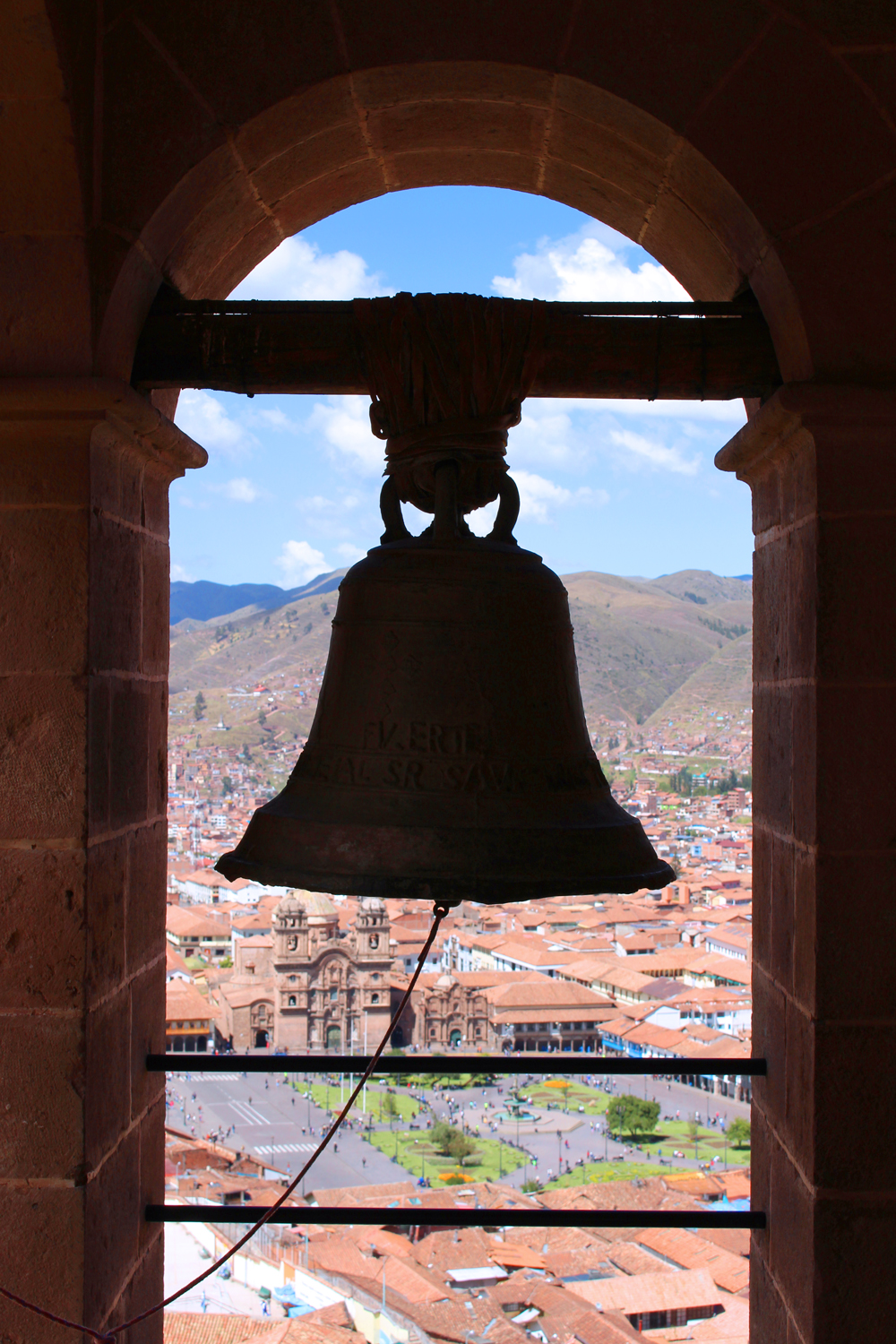 Bell tower overlooking in Cusco, Peru - lifestyle & travel blog