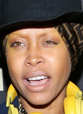 Nigerian top secret photos erykah badu pierces close to for Erykah badu real tattoos