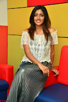 Eesha in a cute deep neck top and Skirt at at Big FM 028.JPG