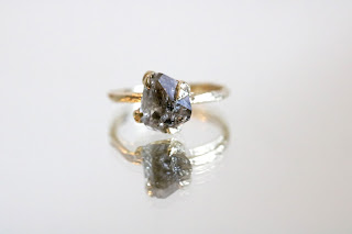 https://www.pigeondynamite.com/collections/ring/products/diamond-quartz-gold-ring