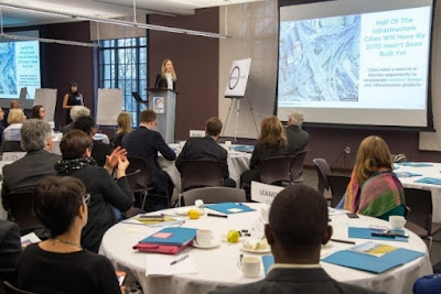 Attendees watching a presentation at the ResilientTO 100 Resilient Cities Toronto Workshop