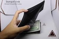 Dompet unik bermotif uang