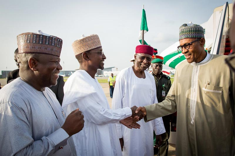 Do you want to wrestle with me? I'm OK now - Buhari tells journalists as he lands in Abuja