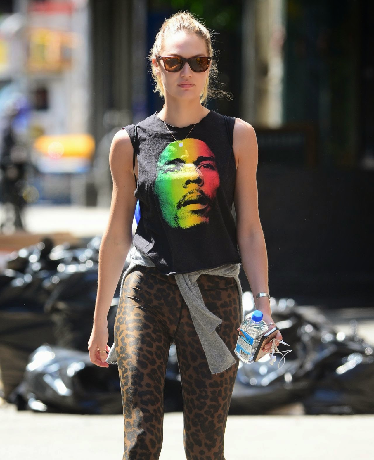 Candice Swanepoel in leopard print leggings and Bob Marley shirt in NYC