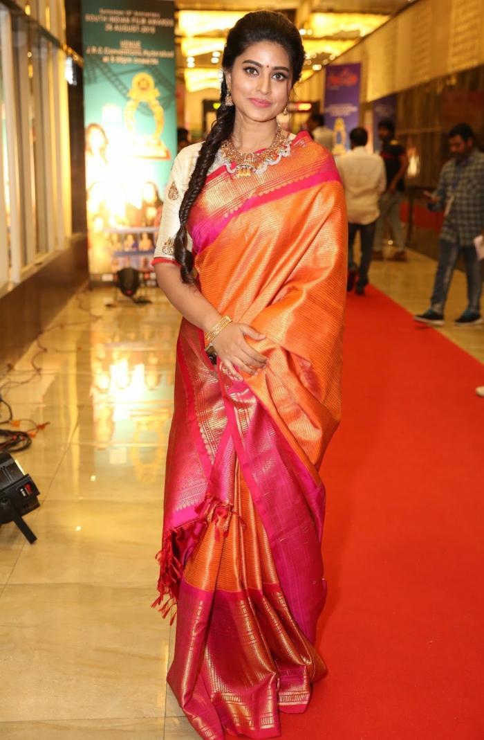 Indian Actress Sneha In Orange Traditional Indian Pattu Saree At