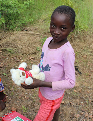 OCC Shoebox girl from Zambia with her stuffed animal.