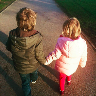Kids holding hands on valentines day