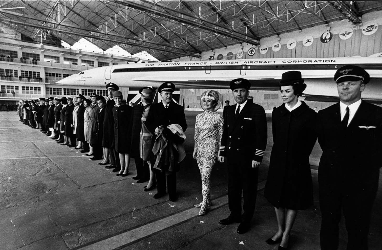 Pilots and flight attendants from airliners which have ordered the Concorde stand in front of the plane at the official roll-out ceremony in Toulouse. 1967.