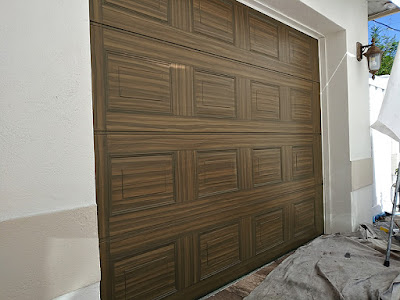 single car garage door painted to look like wood