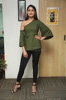 Pragya Jaiswal in a single Sleeves Off Shoulder Green Top Black Leggings promoting JJN Movie at Radio City 10.08.2017 062.JPG