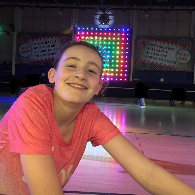 sasha grinning at roller rink