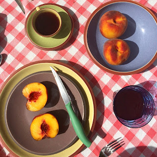 Fresh Peaches on Breakfast Table in Tuscany on Red Gingham Tablecloth