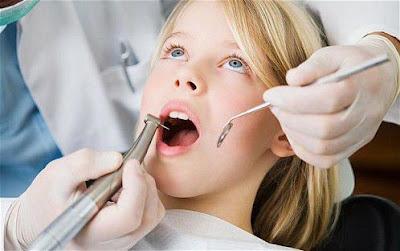 Răng cấm có nên nhổ không?