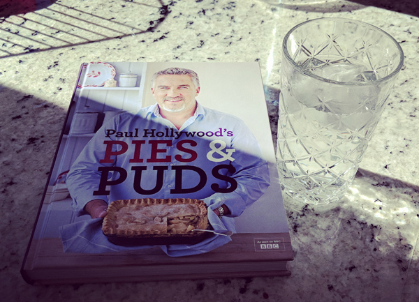 image of a copy of the cookbook 'Pies & Puds' sitting on my kitchen counter, next to a glass of ice water