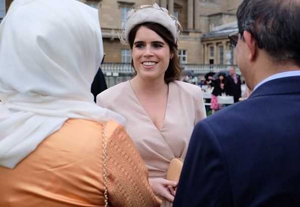 Princess Eugenie wore Sandro wrap dress. Princess Beatrice wore The Vampire's Wife floral-print silk dress. Duke of Sussex