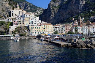 Amalfi occupies a spectacularly beautiful setting on the  Campania coast between Naples and Salerno