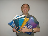 A photograph of me holding all five editions of Intermediate Physics for Medicine and Biology.