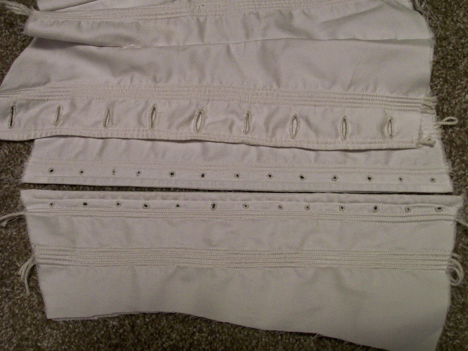Hand sewn eyelet and button holes on an 1850s style corded corset.