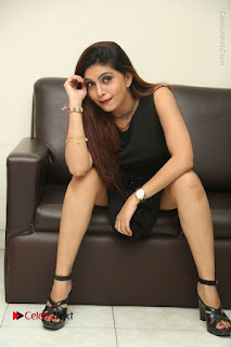 Tollywood Upcoming Actress Pooja Roshan Stills in Black Short Dress at Plus 1 Movie Trailer Launch  0300.JPG
